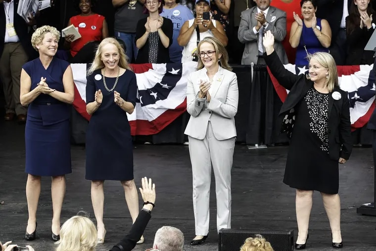 In this Sept. 21, 2018 photo, Pennsylvania congressional candidates, from left, Chrissy Houlahan, Mary Gay Scanlon, state Rep. Madeleine Dean and Susan Wild, take part in a campaign rally in Philadelphia. Each of the Democratic candidates won their elections on Nov. 6 and are set to become the first women from Pennsylvania to serve full terms in Congress since 2014. They all were backed by gun-control groups.
