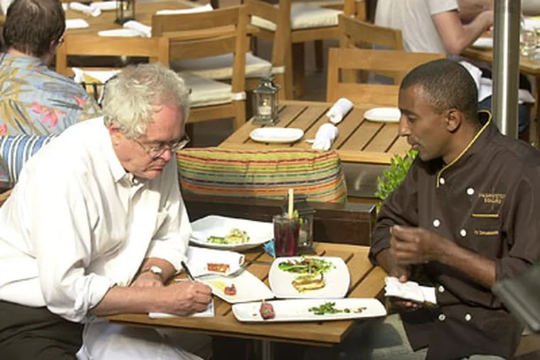 Nichols polishes off a few plates with chef Marcus Samuelsson at Washington Square restaurant in 2004. (Archive staff photo)