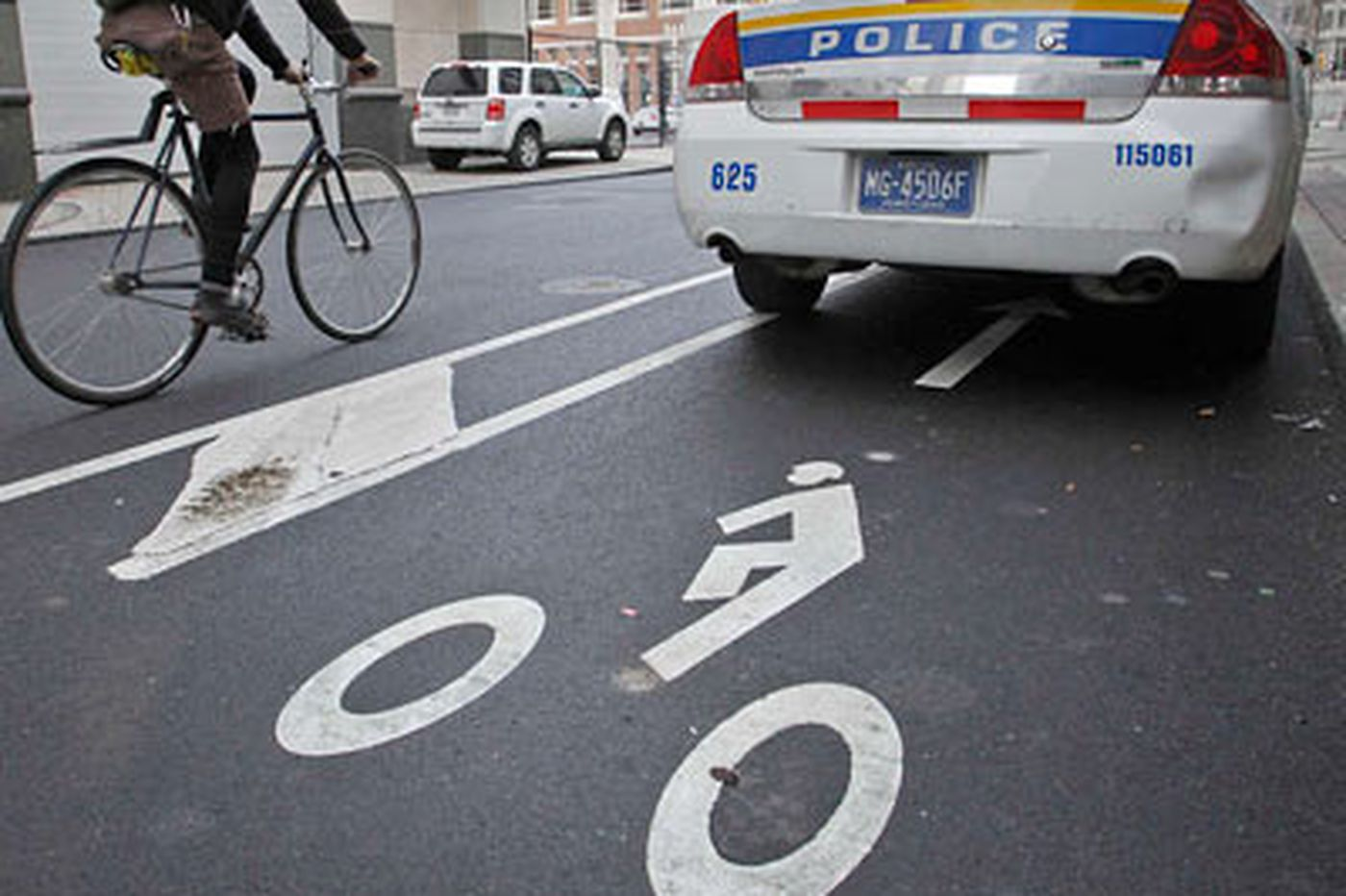Bikers yield to cop cars