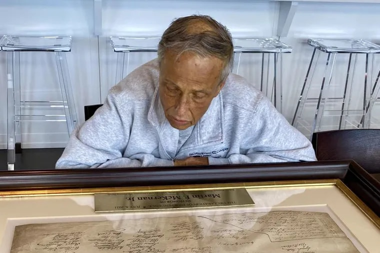 Martin F. McKernan Jr., long-time Norcross family friend, looks at the rare copy of the Declaration of Independence purchased by the family in his honor.