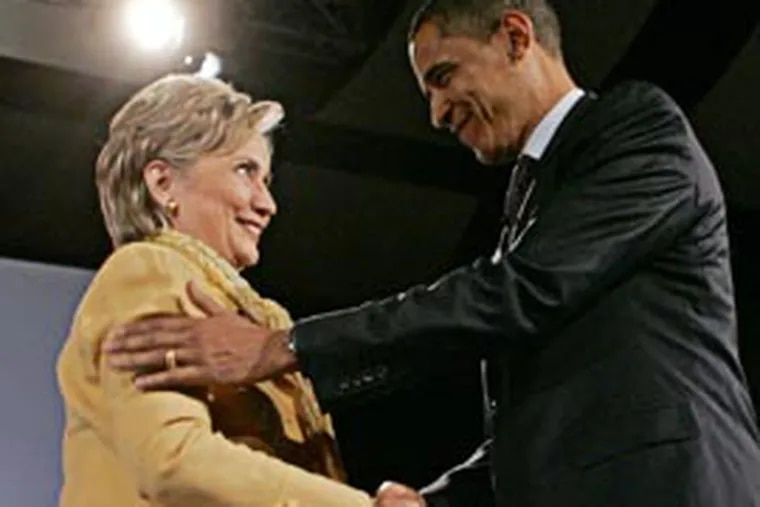 Democratic presidential hopefuls, Sen. Barack Obama, D-Ill., right, and Sen. Hillary Rodham Clinton, D-N.Y., shake hands at the Compassion Forum held at Messiah College in Grantham, Pa., Sunday. (AP)