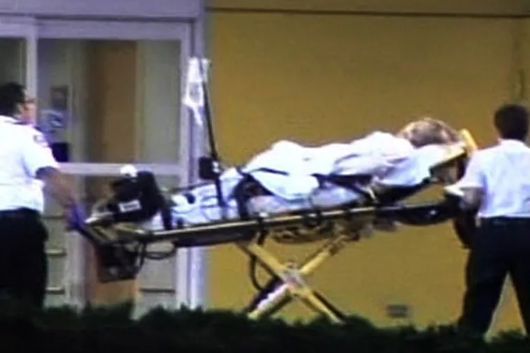 This image taken from video provided by AP Television News shows an unidentified woman being brought into Health Central hospital in Ocoee, Fla. today. (AP Photo/AP Television News)