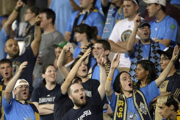 Union fans, known as the Sons of Ben, cheering at PPL Park, are subjects of Jeffrey C. Bell's documentary. (YONG KIM / Staff Photographer)