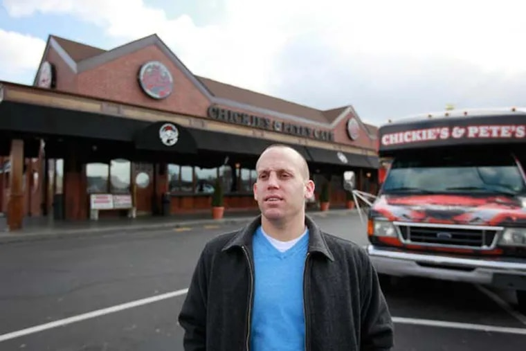 Andrew Laplante in front of Chickie's and Pete's Cafe on Packer Avenue in south Phila., February 20, 2013. ( DAVID SWANSON / Staff Photographer )