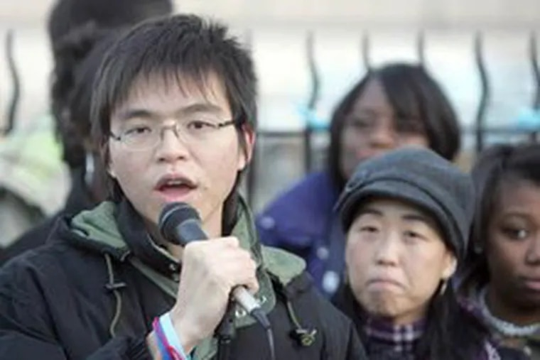 Duong Nghe Ly, left, and Helen Gym, right, speak during a rally last year in front of South Philadelphia High School at Broad and Snyder. Ly was awarded the Princeton Prize on Race Relations. (Staff File Photo)