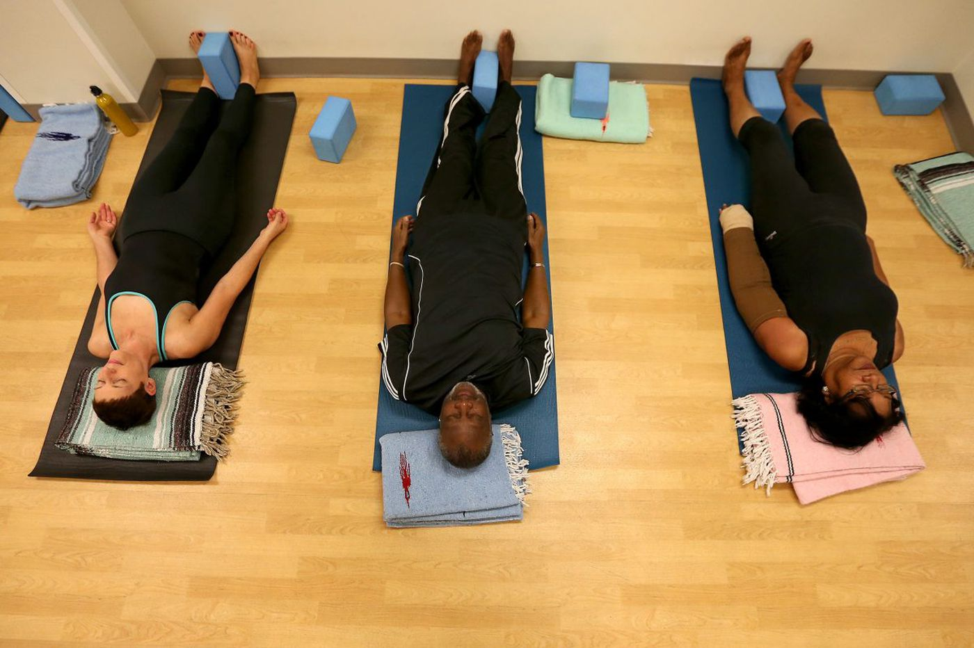 Cancer centers embrace yoga and other alternative therapies to combat patients' pain, fatigue
