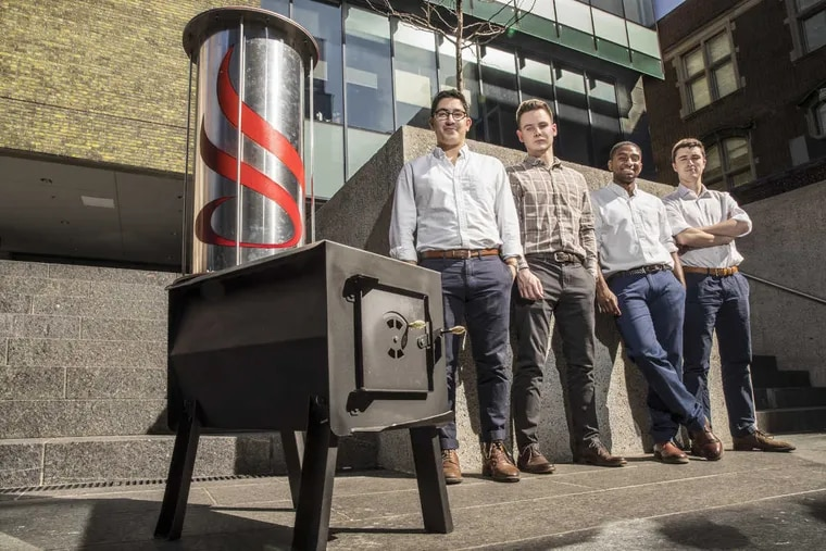 Mazin Blaik, Stephen Michalowski, Justin Gonsalves, and Kellen Sanna designed the cylinder on top of this traditional wood-burning stove for their senior engineering project at Penn. When filled with gravel, the attachment reduces heating costs by one-third, they said.