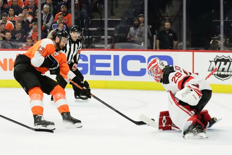 Flyers center Kevin Hayes (left) shoots on Devils goaltender Mackenzie Blackwood last season. Hayes said having the same coaching staff back will make a big difference this season.