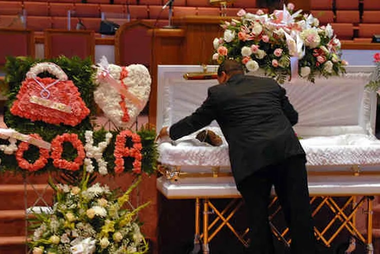 Funeral director Ricky Rivera Sr. (above) readies Aaliyah Griffin's casket before yesterday's viewing. (Below) her mother, Kaillalah Griffin; stepfather, Teddy Griffin (right), and father, Frank Savage.
