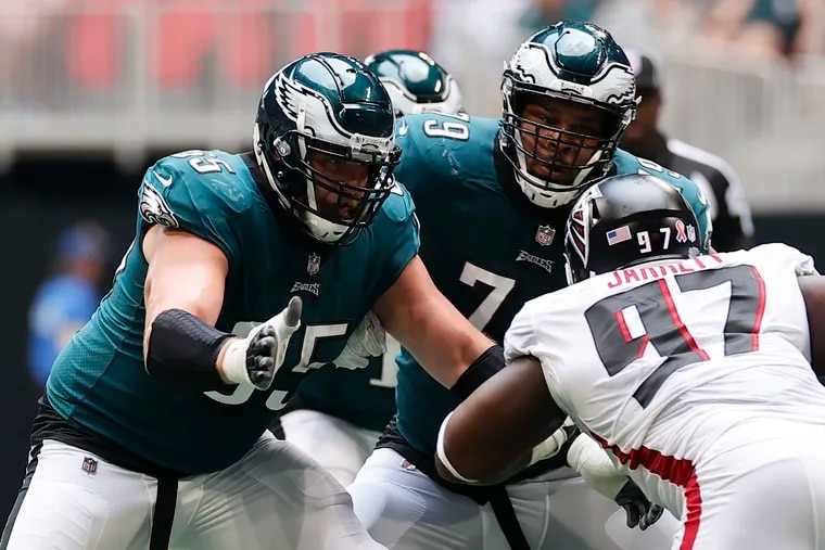 Eagles offensive linemen Lane Johnson and Brandon Brooks block Atlanta Falcons defensive tackle Grady Jarrett on Sunday, September 12, 2021 in Atlanta.
