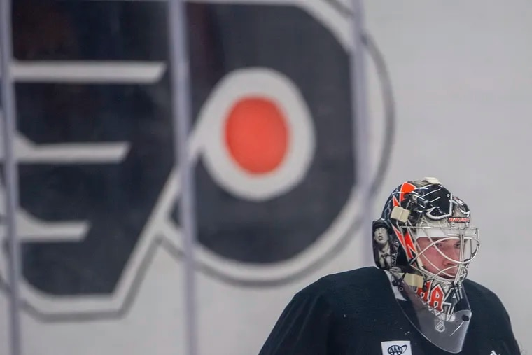 Goaltender, Carter Hart looks on during the first day of Flyers training camp at the Skate Zone in Voorhees, N.J. Thursday, Sept. 23, 2021.