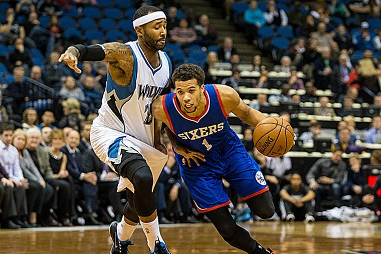 76ers guard Michael Carter-Williams dribbles past Timberwolves guard Mo Williams during the first quarter. (Brace Hemmelgarn/USA Today Sports)