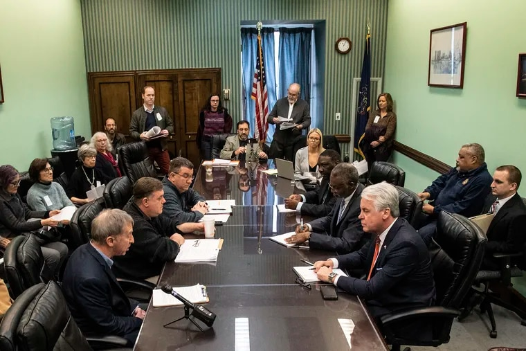 Tim Brown, an organizer with advocates for hand-marked paper ballots (front on the left), speaks during a Philadelphia city commissioners meeting at City Hall on March, 6, 2019. At the table, Commissioner Anthony Clark (third from front on the right) listens with acting commissioners Judge Giovanni Campbell (center on the right) and Judge Vincent Furlong (front on the right).