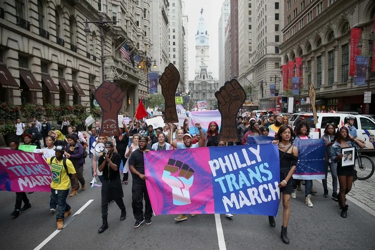 Marchers walk down Broad Street during the eighth annual Philly Trans March in Center City, Philadelphia on Saturday, Oct. 6, 2018. City Council on Thursday unanimously passed the bill that would make the School District of Philadelphia's relatively progressive guidelines a uniform, citywide nondiscrimination policy.