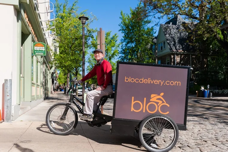 Bloc Delivery's e-bikes can reach a maximum speed of 15 miles per hour and can hold up to 10 trips' worth of groceries.