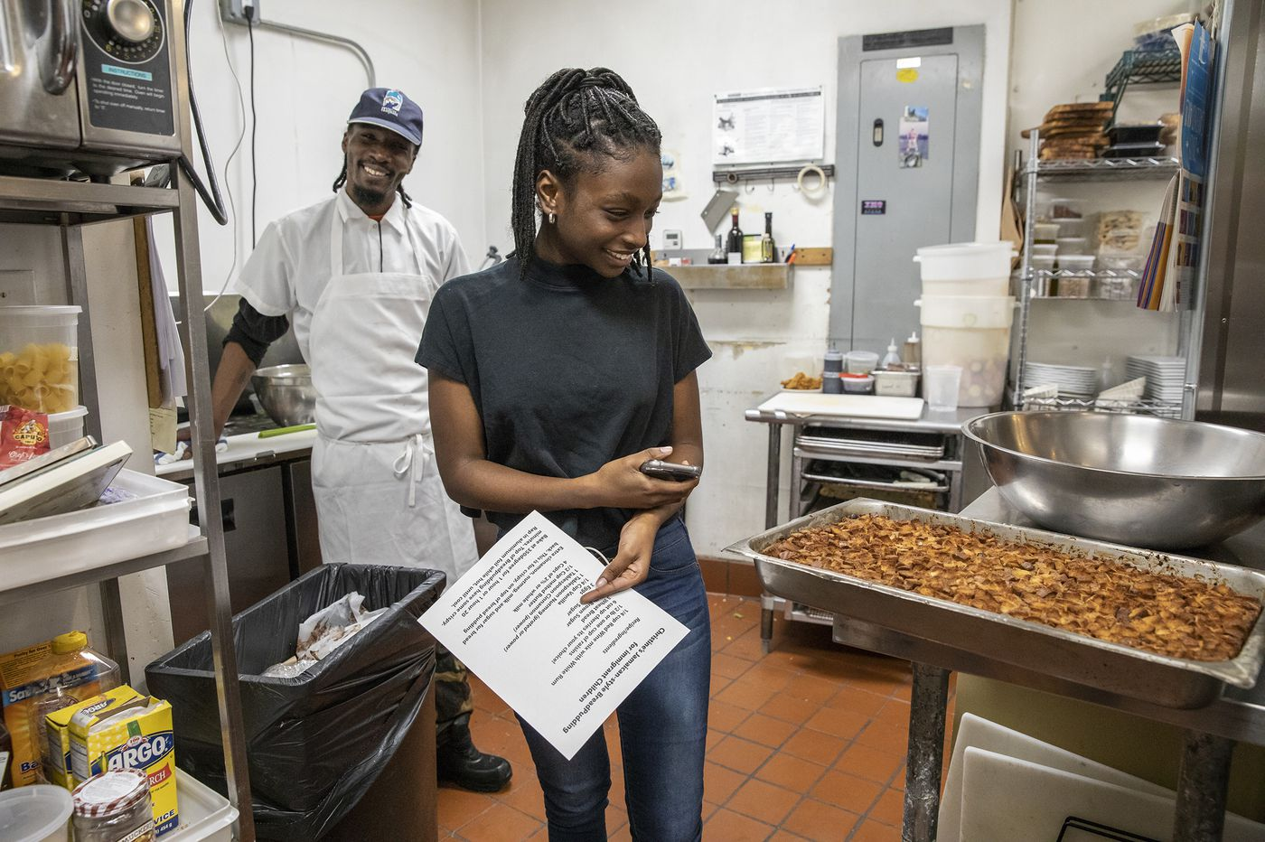 One piece of bread pudding at a time, a famed South Philly restaurant supports immigrants around the world | Helen Ubiñas