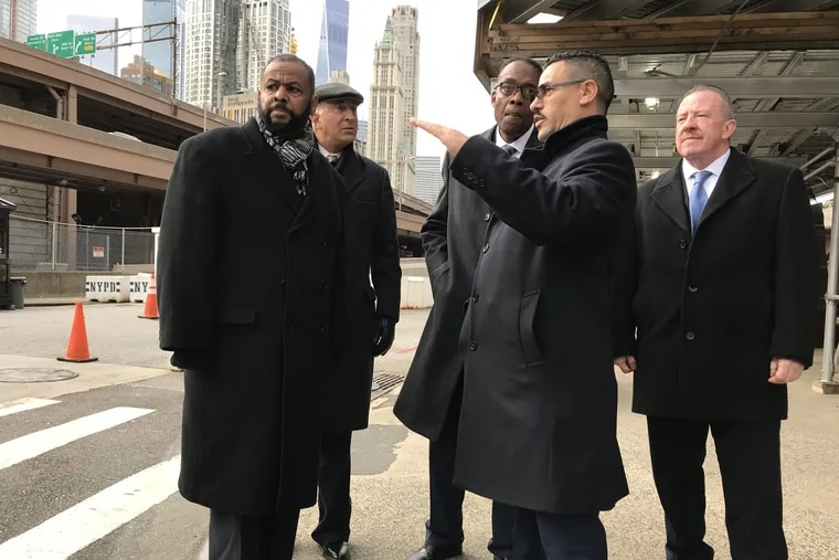 Philadelphia City Council members (L to R) Curtis Jones, Mark Squilla, and Darrell Clarke discuss traffic enforcement with New York City police detective Ahmed Nasser and Philadelphia Police Inspector Walt Smith outside police headquarters on the Lower East Side.