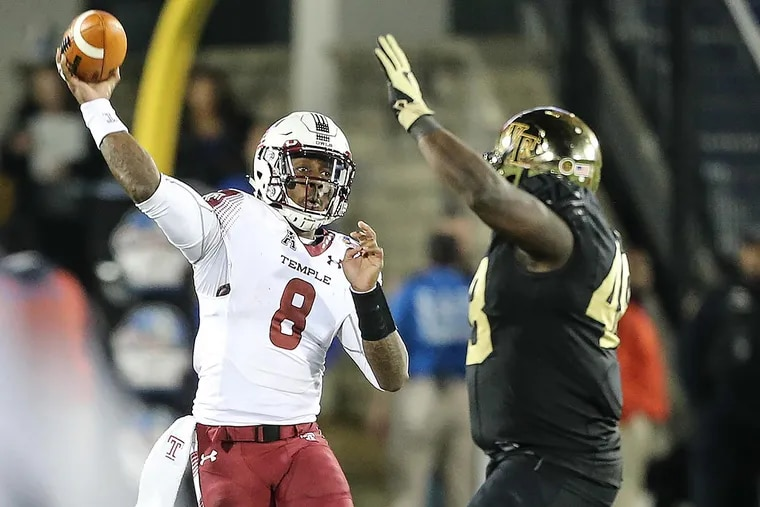 Temple's quarterback Phillip Walker throws a pass around Wake Forest's Willie Yarbary.