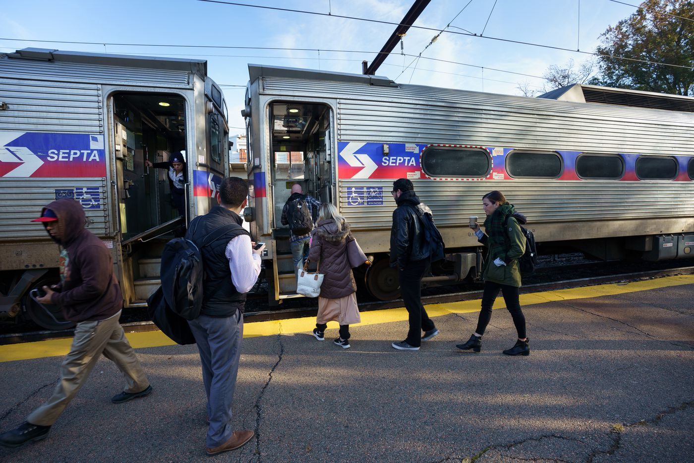 Commuters at the East Falls Regional Rail SEPTA Station, where people have not yet begun to use the SEPTA key cards to board regional rail heading into the city, but some use the key cards to board regional rail from center city stations, in Philadelphia, November 11, 2019.