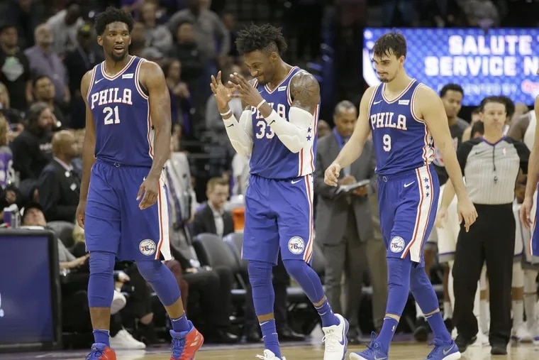 Philadelphia 76ers forward Robert Covington, center, reacts to a call as he walks off the court during a timeout with team members, Joel Embiid, of Cameroon, left, and Dario Saric, of Croatia, during the second half of an NBA basketball game against the Sacramento Kings, Thursday, Nov. 9, 2017, in Sacramento, Calif. The Kings won 109-108. (AP Photo/Rich Pedroncelli)