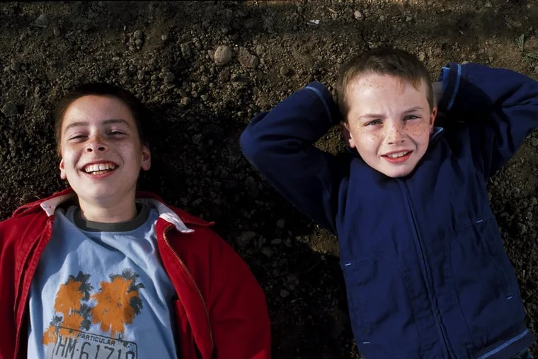 "Lewis McGibbon and Alex Etel in ""Millions."""