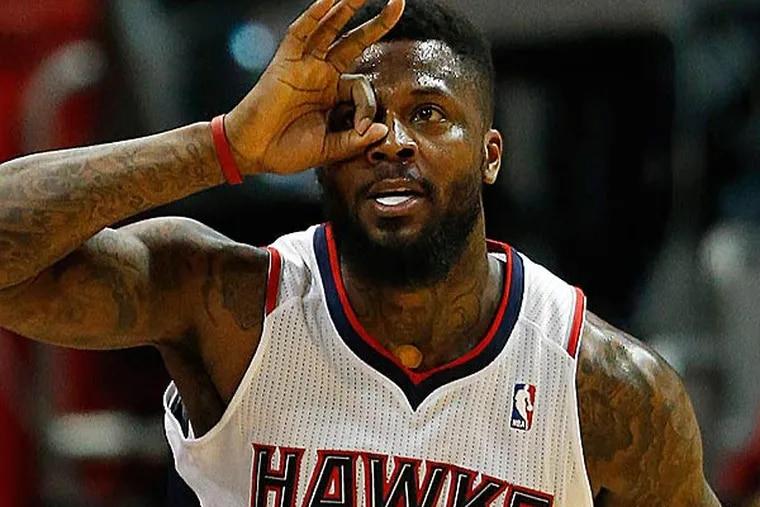 Atlanta Hawks shooting guard DeShawn Stevenson reacts after sinking a three-point basket. (John Bazemore/AP)