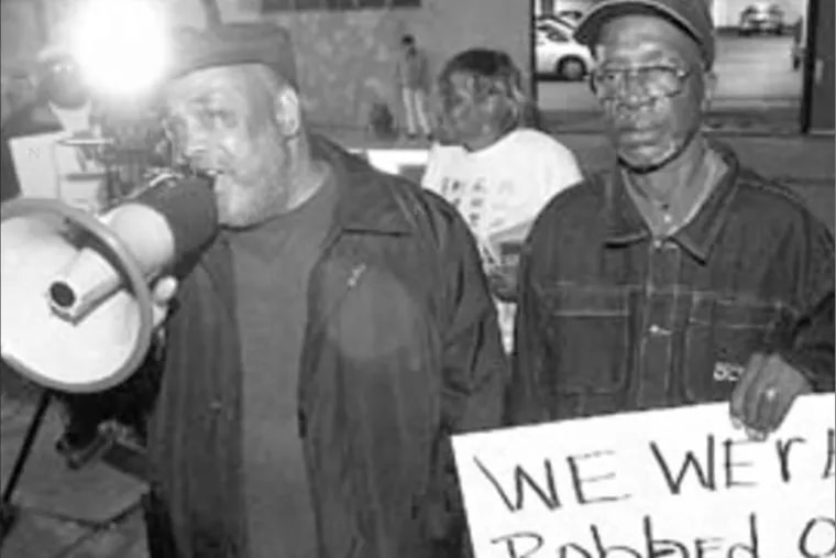 Leodus Jones (left) and Warren Summers, former inmates at Holmesburg Prison, in an Inquirer file photo from Oct. 29, 2003. They're protesting an award given to Albert Kligman, a University of Pennsylvania dermatologist who developed Retin-A and who conducted experiments at Holmesburg.