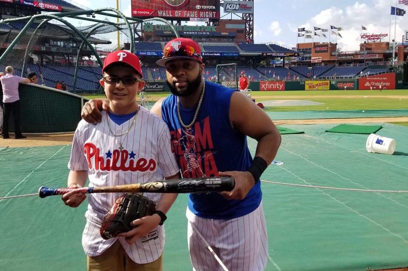 The Phillies' Carlos Santana promised a leukemia patient he'd hit a homer. Then he did.