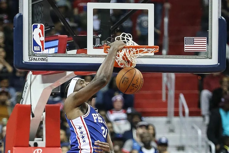 Sixers' Joel Embiid dunks against the Wizards.