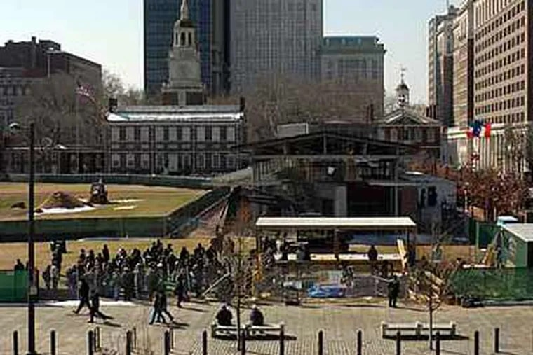 In this 2007 file photo, guests and dignitaries gather at the Independence National Historical Park where president George Washington kept slaves for the ceremonial ground-breaking for a monument at the site. (Tom Gralish / Staff Photographer)
