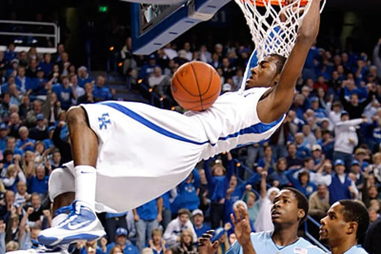 Kentucky freshman sensation John Wall has been projected as the No. 1 pick in next year's NBA draft. (Ed Reinke/AP file photo)