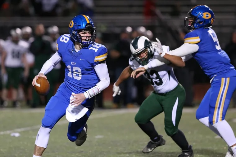 Quarterback Will Howard of Downingtown West (with football) is The Inquirer's Southeastern Pennsylvania Player of the Year.