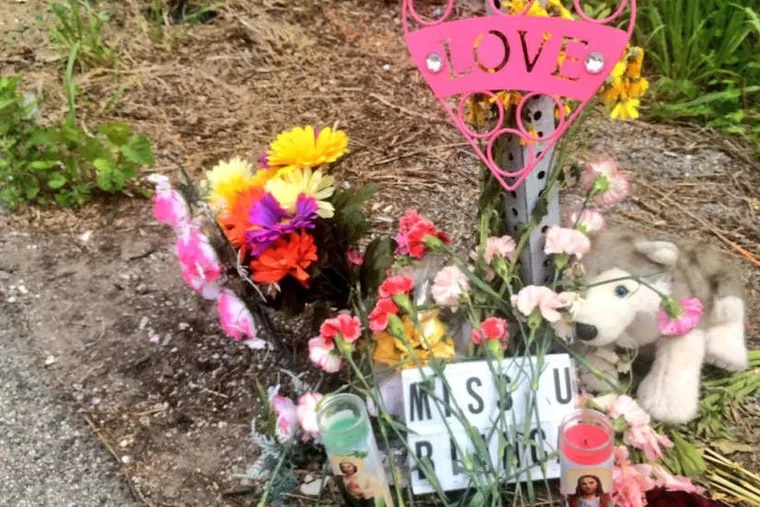 Items left in memory of Bianca Roberson at site of what police say was her road-rage killing.