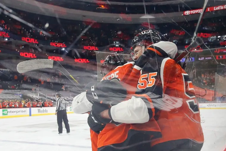 Flyers defenseman Samuel Morin celebrates his game-winning third period goal with teammate Shayne Gostisbehere against the New York Rangers on Saturday. It was Morin's first NHL goal.