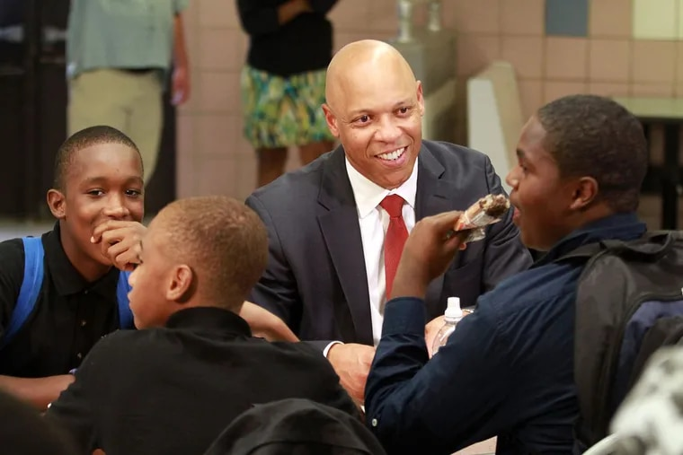 Dr. William R. Hite Jr., Superintendent of The School District of Philadelphia, has lunch, a salad, with 9th-grader John Span, and other South Philadelphia High School students in the cafeteria.