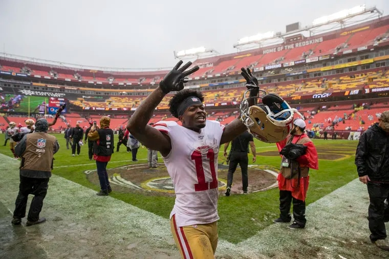 New Eagles wide receiver Marquise Goodwin, playing for the 49ers, leaves FedEx Field last season after a victory over the Redskins. (AP Photo/Alex Brandon)