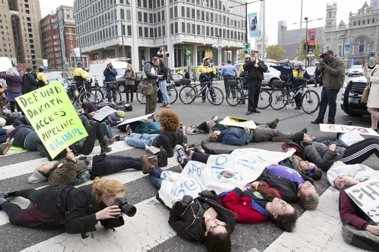 Demonstrators block traffic at 15th Street and JFK Boulevard as part of Tuesday's national day of protest against the Dakota Access Pipeline.