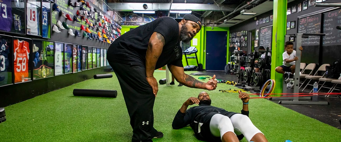 """Greg Garrett, 46, of West Philadelphia,  owner and head strength coach at Level 40 Training and Performance Center,  working with NBA player Marcus Morris, his brother Markieff Morris, and B.J.. Johnson on their upper body in July. Garrett has been owner of his facility for seven years training the Morris twins about five years. """"We build relationships like no other,"""" Garrett said. """"That bond that you get and to see these guys from nothing to big-time athletes."""""""