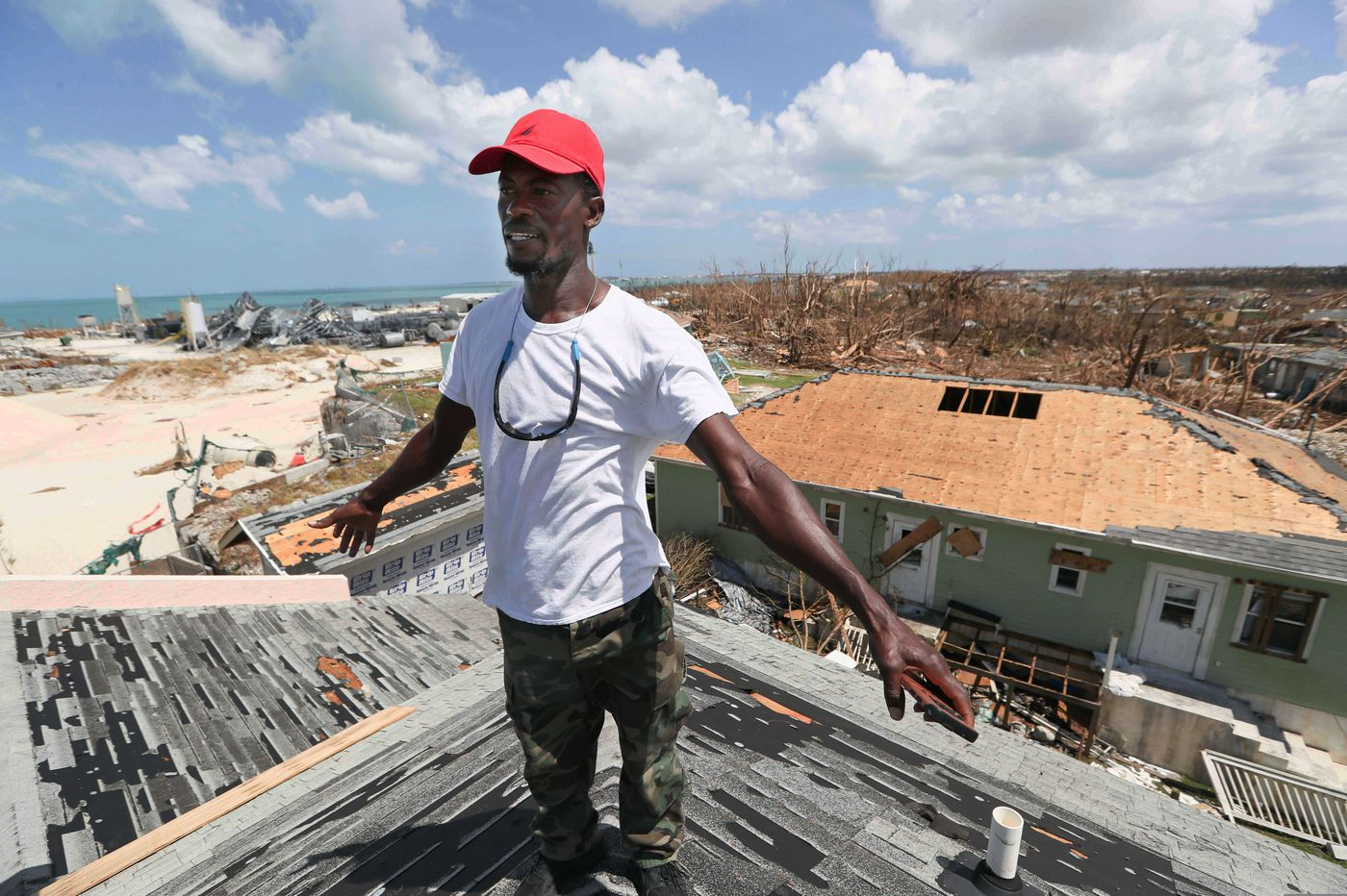 Silence, devastation mark Bahamas town; but some are staying