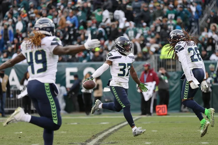 Seahawks safety Quandre Diggs (37) celebrates with linebacker Shaquem Griffin (49) and cornerback Shaquill Griffin (26) after recovering a fumble in the fourth quarter of their Week 12 win against the Eagles. Seattle is the only NFC team the Eagles have never played in the postseason -- until now.