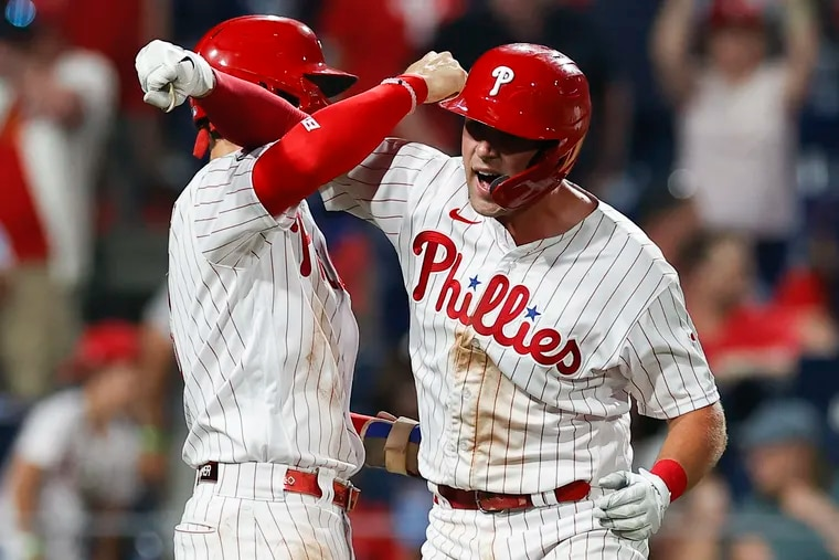 Rhys Hoskins (right) celebrated a home run with teammate Bryce Harper against the Washington Nationals on July 26. Hoskins, sidelined by a groin injury, could return to the lineup this week.