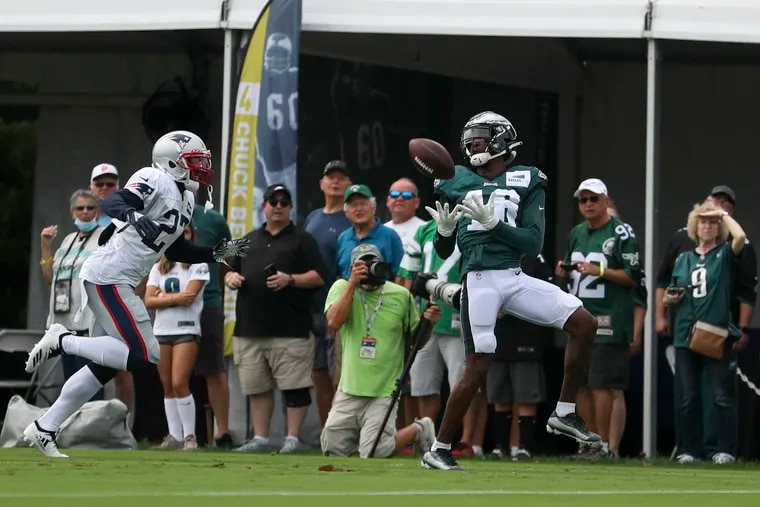 Eagles wide receiver Quez Watkins (right) makes a catch during a joint practice with the Patriots on Monday.