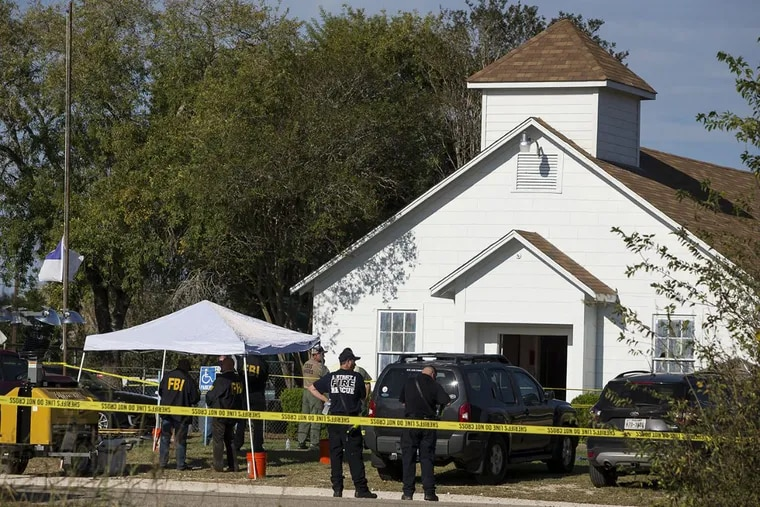 Law enforcement officials investigate a mass shooting at the First Baptist Church in Sutherland Springs, Texas, on Sunday, Nov. 5, 2017.