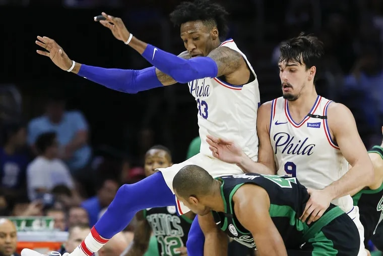 Sixers forward Robert Covington (33) and forward Dario Saric  (9) must be more consistent for the Sixers.