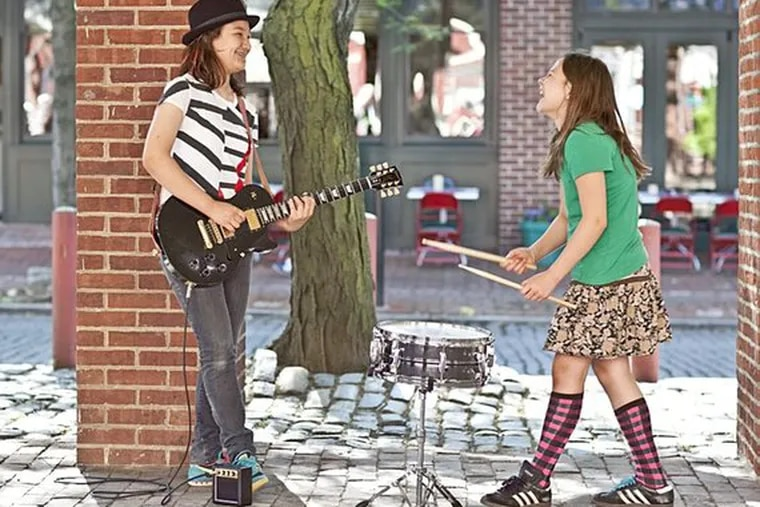 Sisters Kate (left) and Bina Maurer return for another summer with weekend rock-and-roll music at the Street Performer Series.