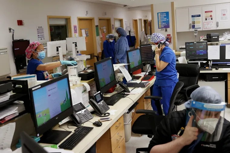 Nurses work at the nurses' station inside a COVID-19 intensive care unit at Temple University Hospital's Boyer Pavilion in North Philadelphia on April 7.