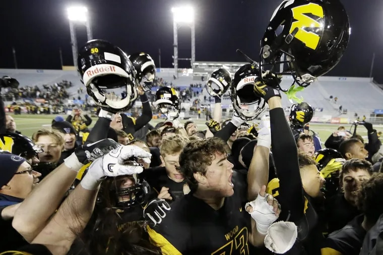 Archbishop Wood players celebrate after beating Gateway, 49-14, for the PIAA Class 5A football championship.