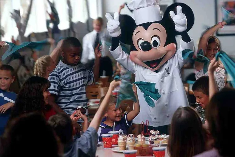 Chef Mickey takes a break from cooking to mingle with guests of Chef Mickey's restaurant at Disney's Contemporary Resort. Breakfast and dinner are offered daily.