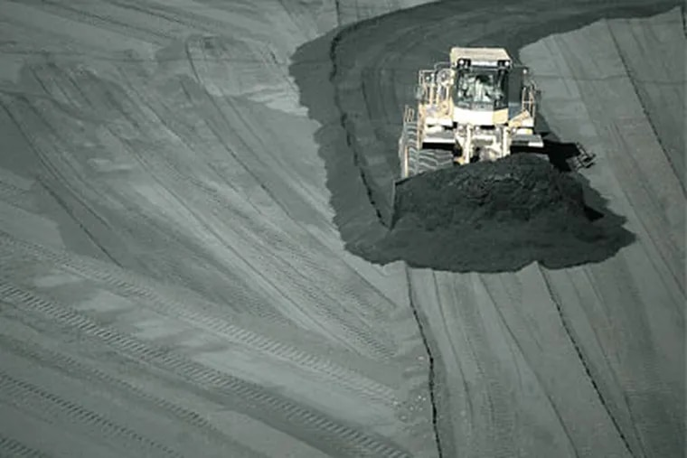 Al Phillip, drives the bulldozier, as he pushes the sea of coal towardthe collection area west of the power plant. Brunner Island PowerPlant: This is the $750 million project that PPL built inanticipation of a Bush/EPA rule that was tossed by the court.
