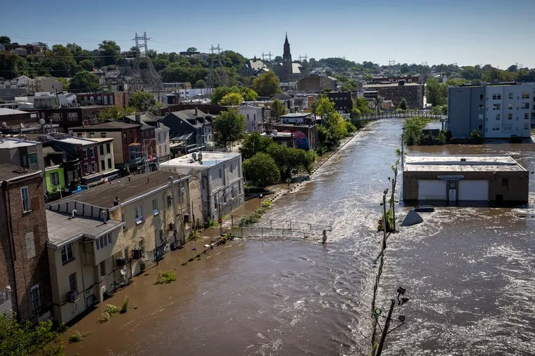 The Schuylkill River and Manayunk Canal overflowed onto the Main Street Manayunk as seen from Manayunk Bridge, Thurday morning. Heavy rain from Hurricane Ida is creating problems with flooding in Philadelphia and region on Thursday, September 2, 2021.